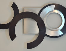 Wall sculpture Circles III  - Corten steel and stainless steel
